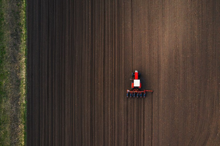 Top view of tractor planting seeds