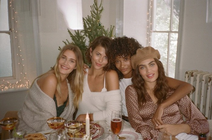 Four women wearing A&F apparel.