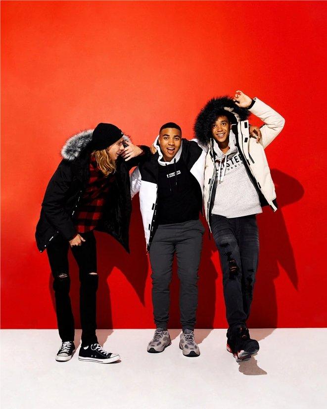 Three men wearing Hollister apparel.
