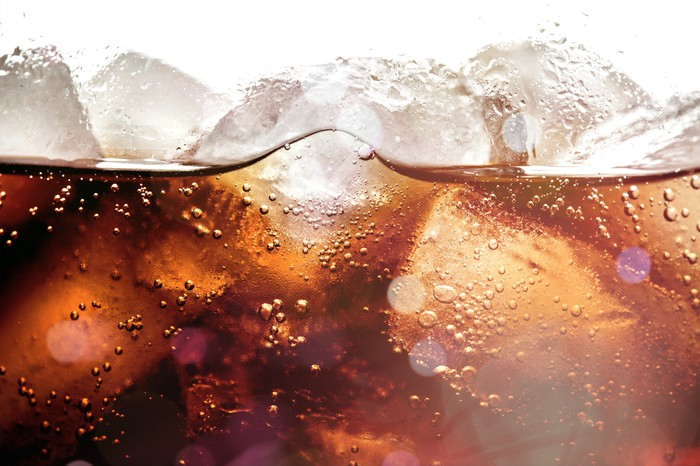 Ice cubes floating in cola.