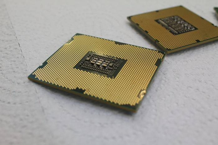 Gold-colored CPU with a similar chip to the back right.