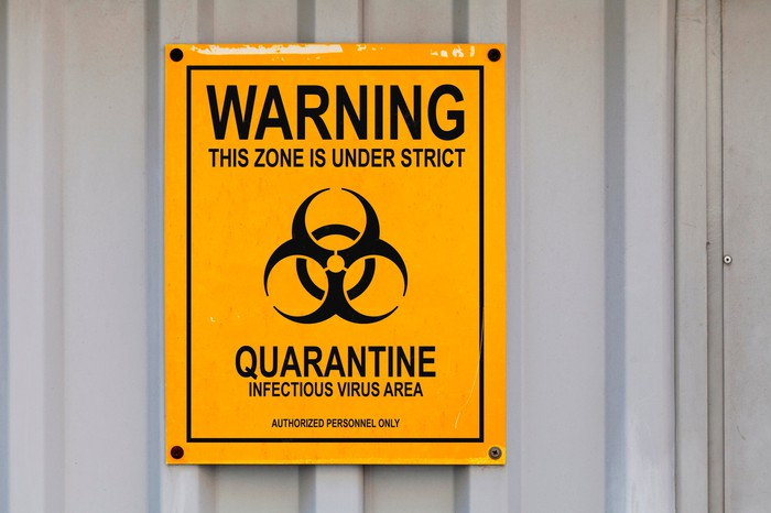 A picture of a quarantine sign on a wall.