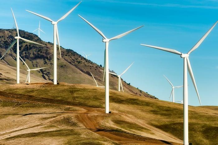 Wind turbines on a hill.
