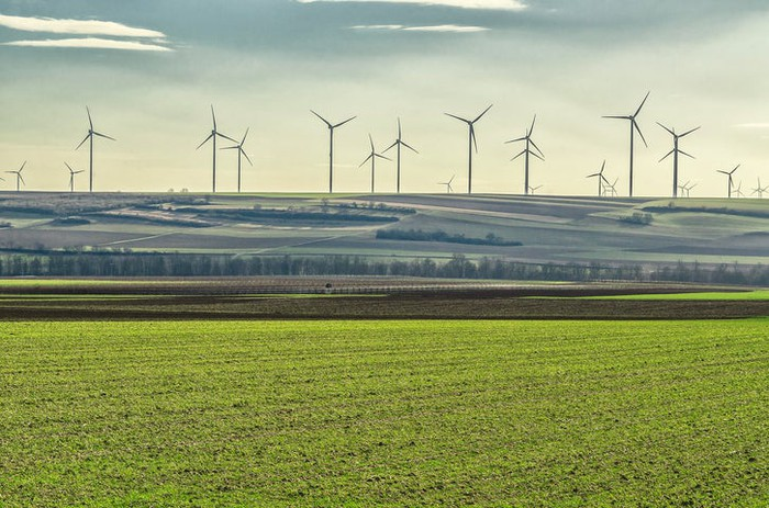 Wind turbines on a hill in the distance.