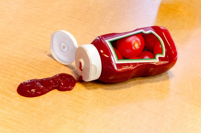 Open ketchup bottle on its side.