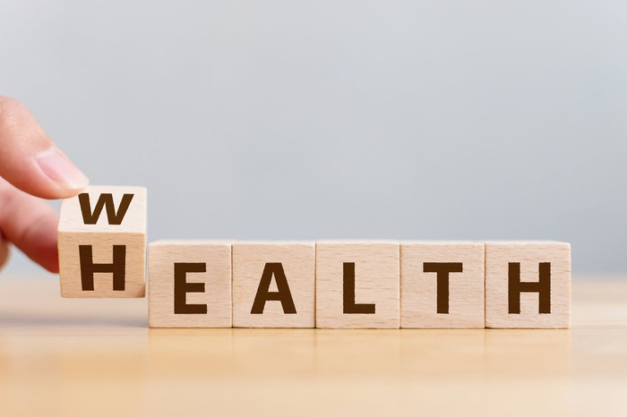 Wooden letter blocks spelling wealth and health