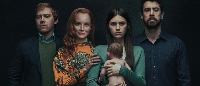 The cast of Servant on Apple TV+ holding a baby.