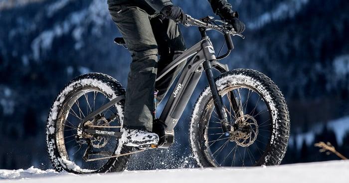 Rider on e-bike in the snow.