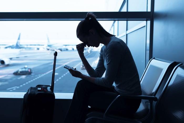 Frustrated traveler waiting at an airport terminal