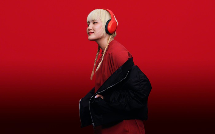 A young woman wears Sony headphones.