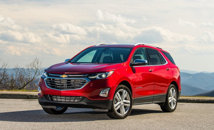 A red 2020 Chevrolet Equinox, a compact crossover SUV