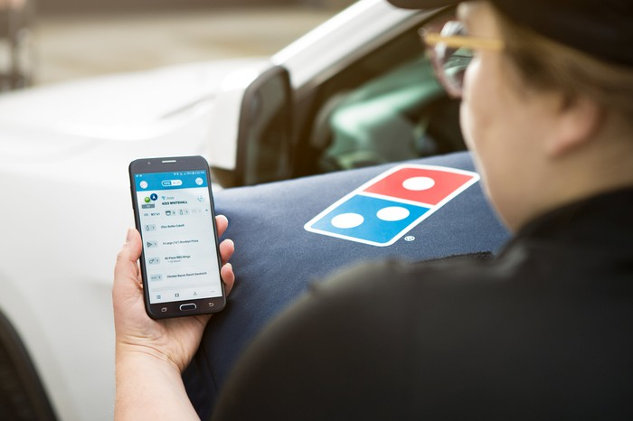 Domino's driver using GPS for delivery instructions