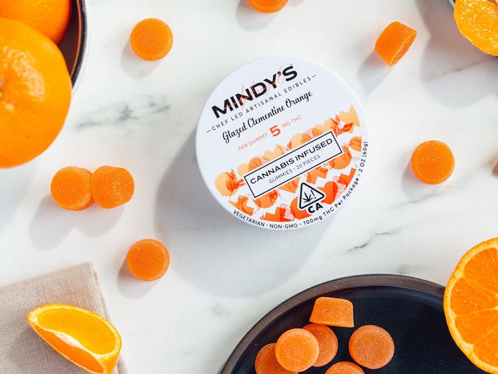 A tin of Mindy's Edibles' Glazed Clementine Orange edibles.
