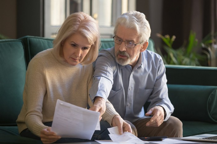 Older man and woman looking at documents.