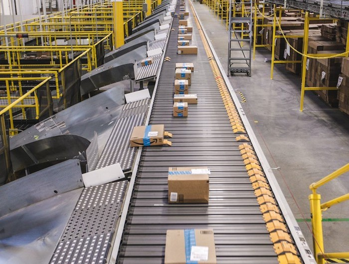 Boxes on a conveyor belt in an Amazon fulfillment center.