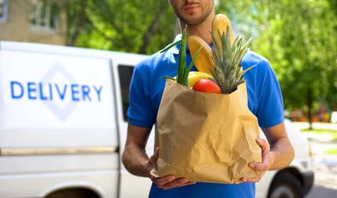 A delivery person deliving groceries