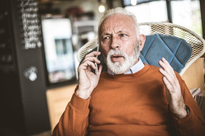 Older man talking on cell phone