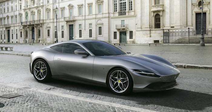 A silver Ferrari Roma, a sleek front-engined two-seat coupe.