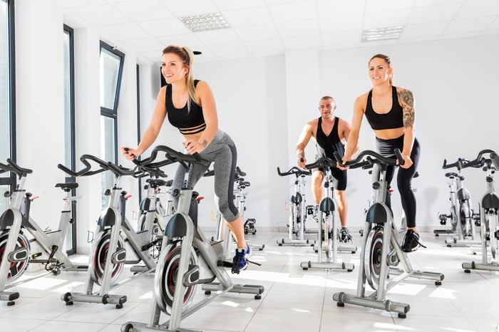 People exercising in a spin class.