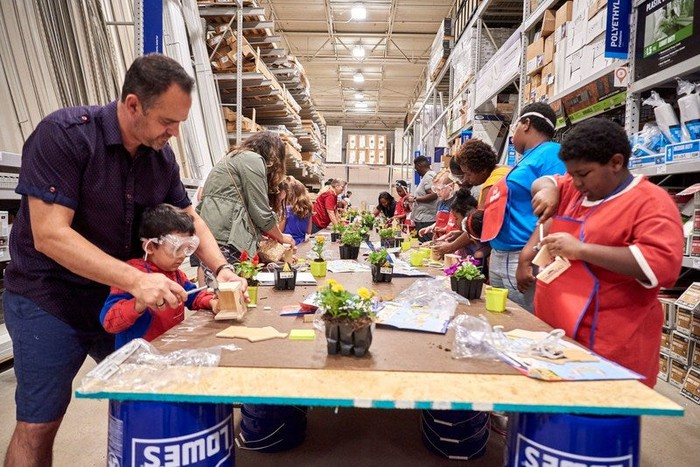 Families take part in a Lowe's workshop.