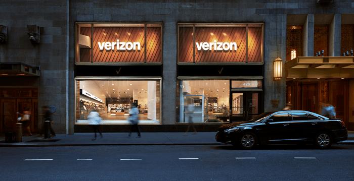 Exterior shot of a Verizon storefront at dusk