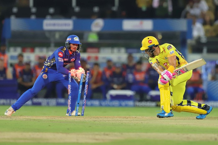Two cricket players on the field during a game