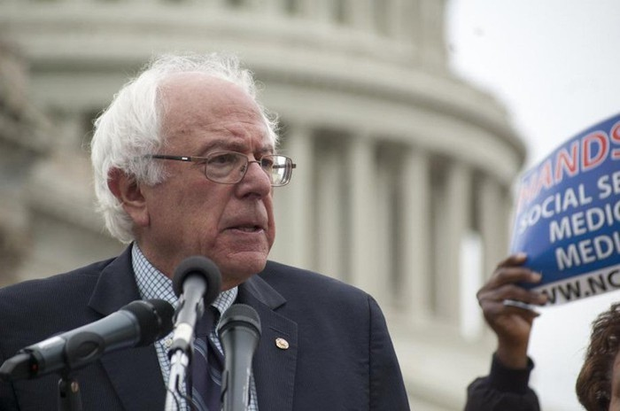 Senator Bernie Sanders giving remarks about Social Security in front of the Capitol building.