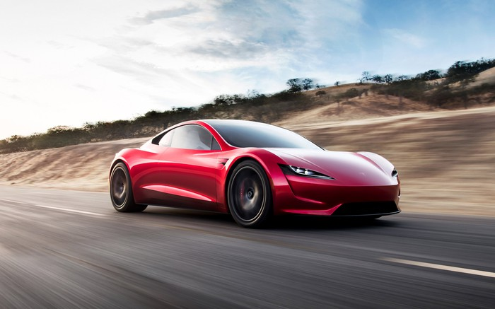Tesla Roadster driving on a highway.