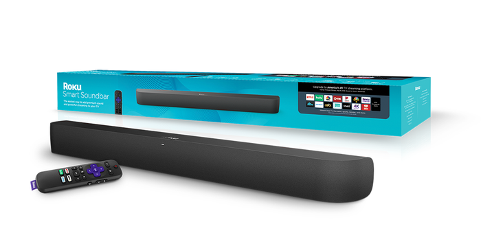A Roku soundbar out of the box along with its remote.