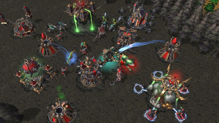 a screenshot from the Activision Blizzard video game Warcraft III: Reforged shows characters battling