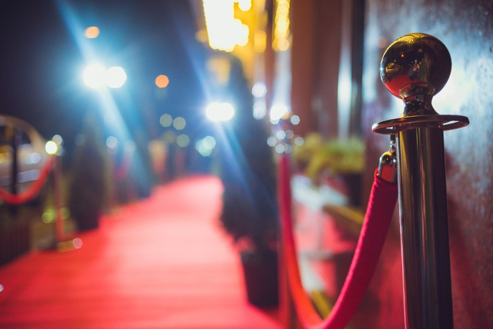 An empty red carpet with lights