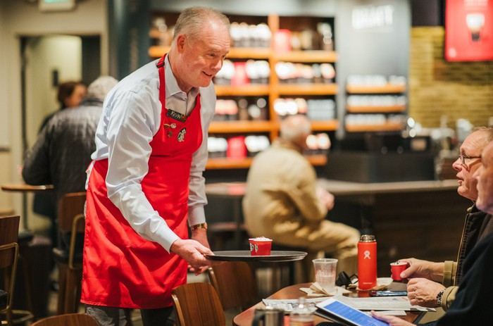Starbucks CEO Kevin Johnson wears one of he company's trademark aprons.