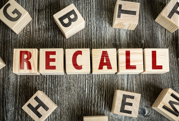 Letters on blocks spell the word recall.
