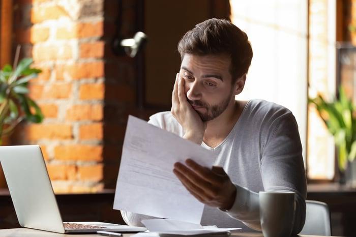 Man reviewing a bill