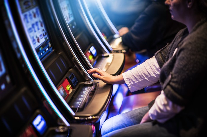 Photograph of slot machines in a casino.
