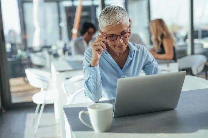 Older woman sitting at laptop