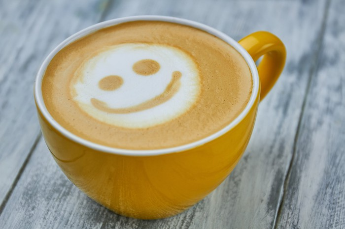A latte with a smiley face in its foam.