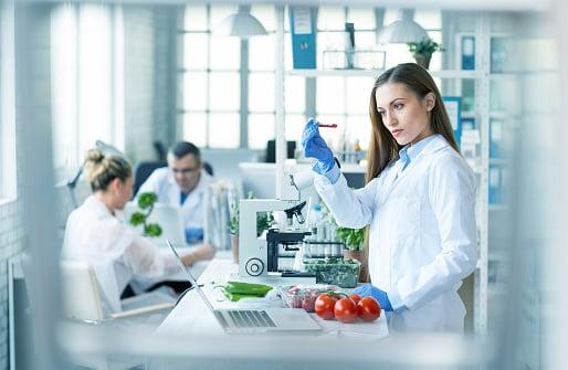 Female scientist in food science lab.