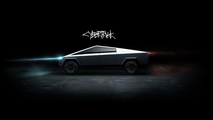 Tesla Cybertruck in a darkly lit room.