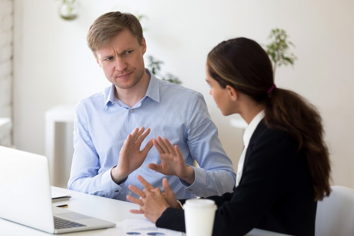 Man rejecting to discuss with business partner.