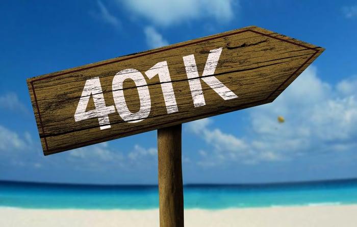 401 (K) arrow sign on a beach pointing up.