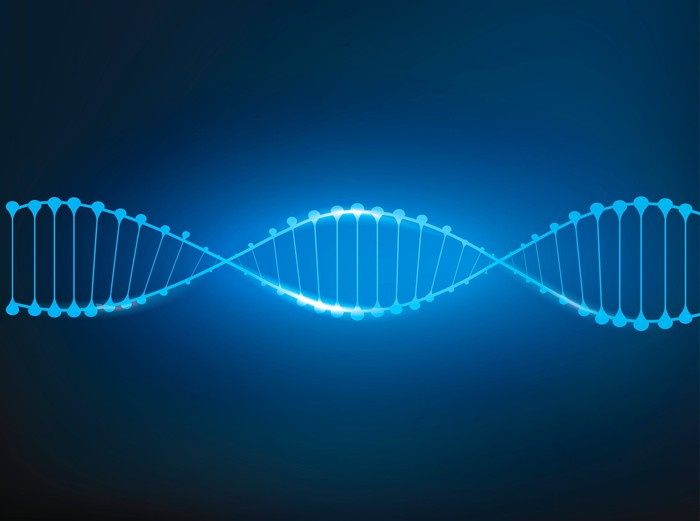 Blue DNA double helix on a dark blue background
