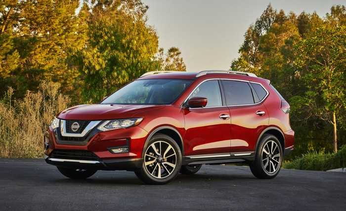 A red 2020 Nissan Rogue, a compact crossover SUV.