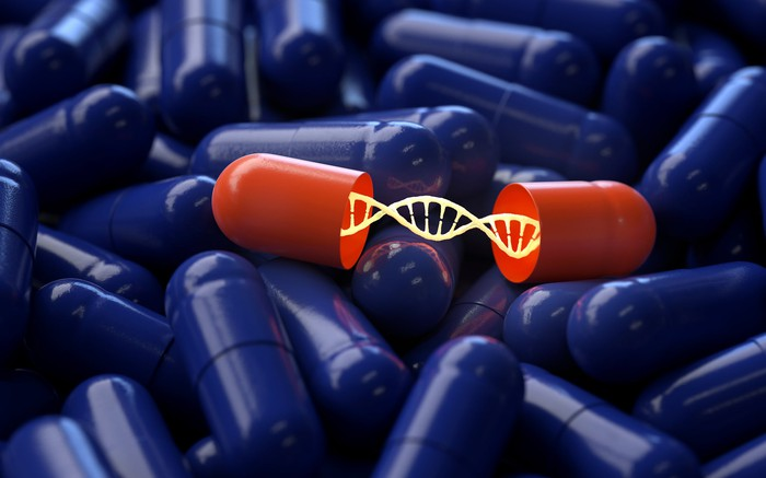 Dozens of blue pills and one open red pill containing a strand of DNA.