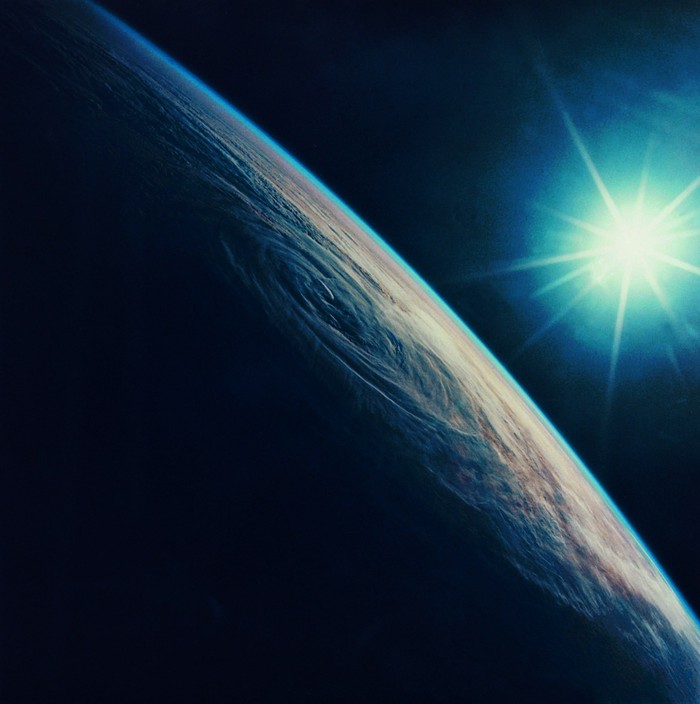 Earth and Sun as seen from low orbit.