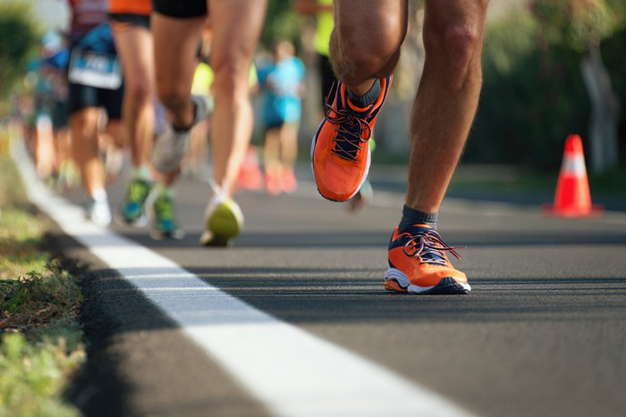 The feet of runners in a road race