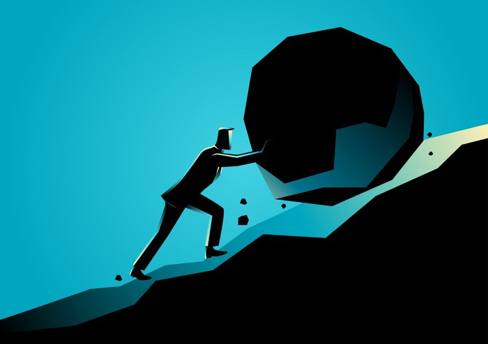 Graphic of man pushing a big rock uphill