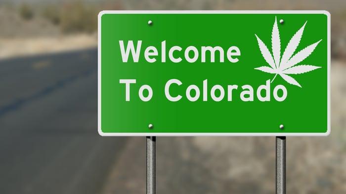 Colorado road sign with marijuana leaf.