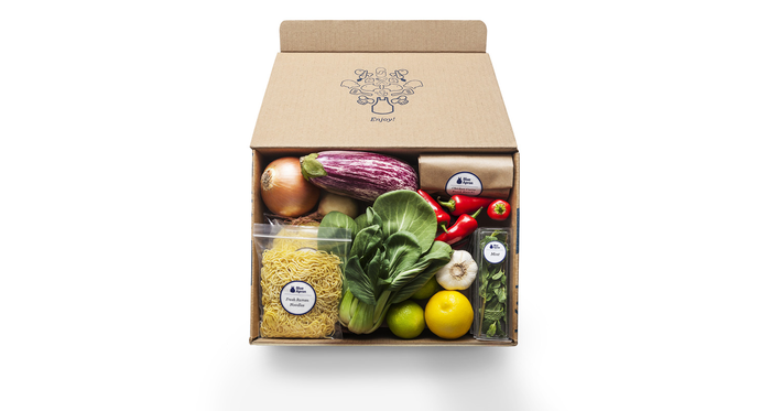 Blue Apron meal kit box filled with ingredients