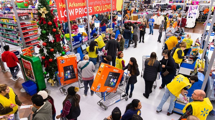 Customers shopping in a Walmart store.